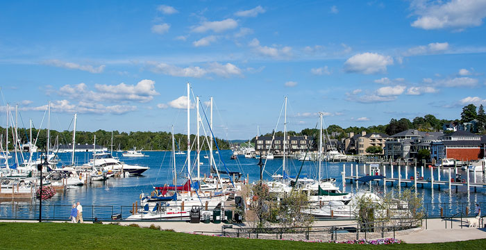 Many people make a loop through the ever-lively Bridge Street and then take a peaceful stroll along the Charlevoix's Round Lake...