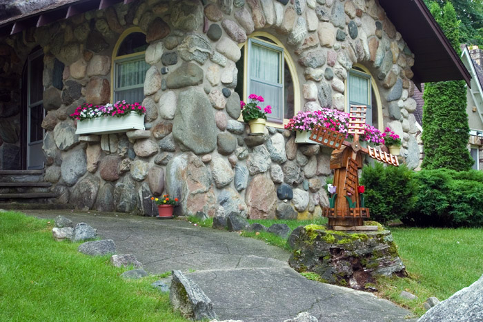 Some people call this cottage the Owl House because of the double arched windows that dominate the front exterior. Built between...