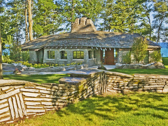 Constructed of Onaway limestone, Young designed the home for William Sucher, founder and president of the Speedway 79 gasoline...