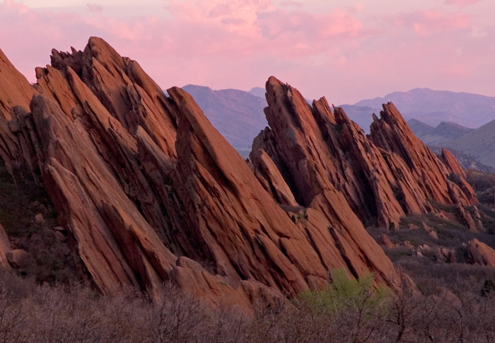 The best light to photograph Roxborough Park is at sunrise because the rocks turn orange/red and contrast well with the deep...