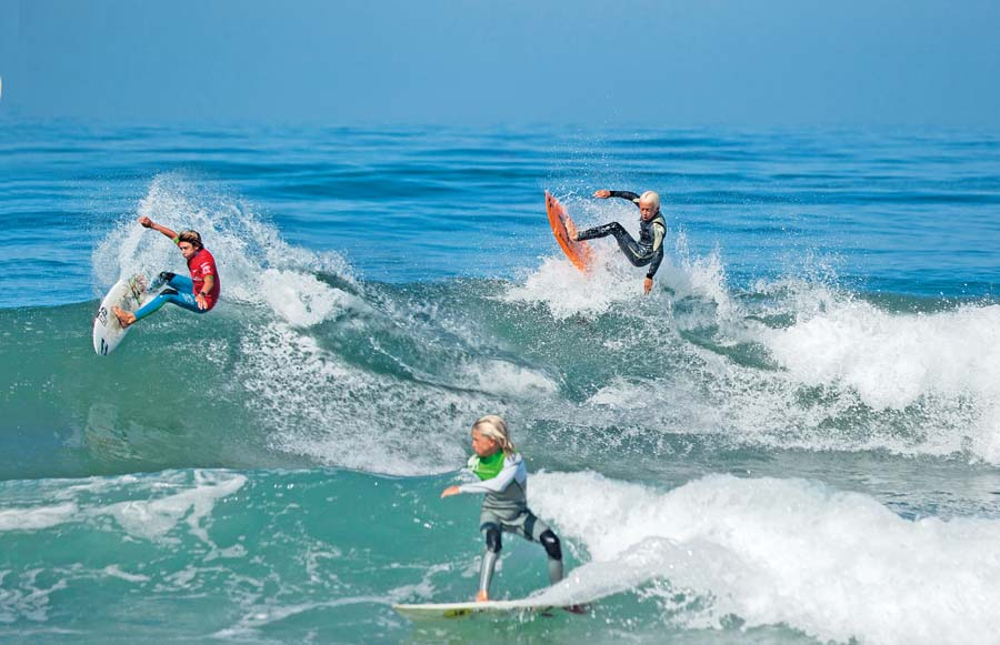 Young surfers participate in the National Scholastic Surfing Association contest at Seaside Beach in Cardiff-by-the-Sea.