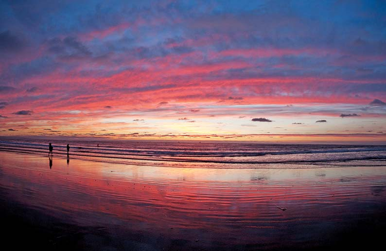 Low tide and saturated sand make it possible to photograph sunset reflections on the beach.